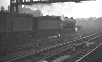 A freight passing to the south of Newcastle Central on the goods lines and heading for the King Edward Bridge on a grey day in 1961. Locomotive  is York B16 4-6-0 no 61444.<br><br>[K A Gray&nbsp;//1961]