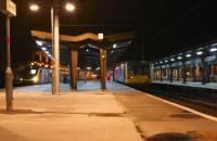 Evening scene at Preston station on 20 December 2014. On the right 142045 awaits departure time at platform 3C with the 2205 service to Ormskirk. On the left is the terminating 1P06 from Euston which is preparing to run as 5H06 to Longsight<br><br>[John McIntyre&nbsp;20/12/2014]