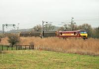 The last <I>Christmas Postal Extra</I> of 2014 heads south behind DBS electric 90035. The train is passing the Hest Bank livery stables approaching the level crossing on 23rd December. The return trip from Sheildmuir to Warrington has been made on most weekdays in December. <br><br>[Mark Bartlett&nbsp;23/12/2014]