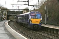 ScotRail 334001, ultimate destination Cumbernauld, leaves Alexandra Parade heading north for Barnhill and Springburn on the morning of 23rd December 2014.<br><br>[Colin McDonald&nbsp;23/12/2014]