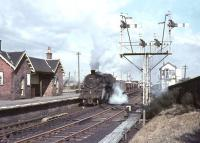 Beattock based BR Standard class 4 2-6-0 no 76098 standing in the platform loop at Symington with an up ballast train on 25 March 1966.<br><br>[John Robin&nbsp;25/03/1966]