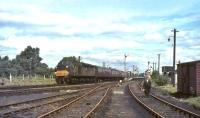 EE Type 4 D320 runs south through Symington station with an up WCML train in July 1965. <br><br>[John Robin&nbsp;10/07/1965]