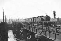 Scene at Strathclyde Junction on 17 May 1957 as Fairburn 2-6-4 tank 42164 brings a train of empty stock north across the river. <br><br>[G H Robin collection by courtesy of the Mitchell Library, Glasgow&nbsp;17/05/1957]