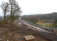 Looking south from Winston Road, Galashiels, on 26 December, with the new road bridge having recently been opened to vehicles. The pedestrian route between Winston Road and Tweedbank via the Red Bridge in the distance is now on the right (west side) of the trackbed, with the old route, visible beyond the barriers on the far left, now closed off. <br><br>[Ewan Crawford&nbsp;26/12/2014]