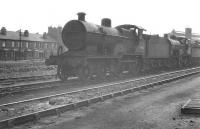 Shed scene at Nottingham in May 1961, with Fowler 2P 4-4-0 40682 at the end of a line of withdrawn ex-LMS steam locomotives awaiting disposal.<br><br>[K A Gray&nbsp;13/05/1961]