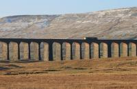The low winter sun illuminates the underside of Ribblehead's arches as Freightliner 66550 makes a light engine run from Carlisle to Leeds on 28th December. <br><br>[Mark Bartlett&nbsp;28/12/2014]