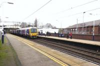 In a path between frequent Virgin and CrossCountry expresses and with its destination blind showing its starting point, Northern Rail 323238 arrives at Congleton with a Stoke-on-Trent to Manchester stopping service on 22 December.<br><br>[Malcolm Chattwood&nbsp;22/12/2014]