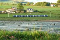 An eastbound Class 334 emu approaching Ardmore East level crossing on the evening of 1 June 2013. Photographed from Ardmore Point looking across to Lyleston Farm.<br><br>[John McIntyre&nbsp;01/06/2013]