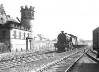 A Bridgeton - Clydebank train about to pass the <I>Yoker Castle</I> sewage facility on 4 September 1958 behind Parkhead V1 2-6-2T no 67616. <br><br>[G H Robin collection by courtesy of the Mitchell Library, Glasgow&nbsp;04/09/1958]