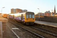 Northern 142037, on a Wigan to Manchester Victoria local service, pulls away from its penultimate stop at Salford Central on 2nd December. Electrification masts are starting to appear around Salford and the Pacers should be the first units to go when the EMUs arrive.<br><br>[Mark Bartlett&nbsp;02/12/2014]