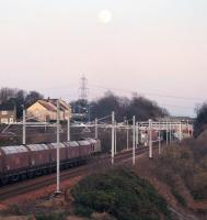 66111 approaches Baiilieston with a Longannet coal train at dusk on 3rd January 2015.<br><br>[Colin McDonald&nbsp;03/01/2015]