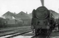 Locomotives in the shed yard at Carlisle Kingmoor on a grey and overcast 17 June 1964. Nearest the camera is locally based BR Standard class 9F 2-10-0 no 92130. <br><br>[John Robin&nbsp;//]