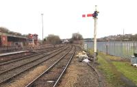 Looking north east from the end of platform 2 at Buxton station on a relatively quiet 5 January 2015. In the distance a class 66 can just be seen taking a northbound freight past Buxton signal box.<br><br>[Bruce McCartney&nbsp;05/01/2014]