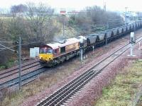 EWS 66233 finally gets underway following a lengthy signal check at the north end of Millerhill Yard in December 2002. The coal empties are destined for Ravenstruther. <br><br>[John Furnevel&nbsp;10/12/2002]