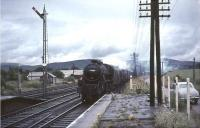 Black 5 44669 about to pass through Symington with a northbound freight in pouring rain on 30 July 1966, some 18 months after the station was closed to passengers.<br><br>[John Robin&nbsp;30/07/1966]