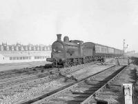 57554 approaching Clydebank Riverside on 14 September 1957 with a Rutherglen - Balloch train. The smokebox door of the Dawsholm based 0-6-0 looks in slightly better condition than in had when operating the same service 6 weeks earlier [see image 49967]. [Ref query 3446]  <br><br>[G H Robin collection by courtesy of the Mitchell Library, Glasgow 14/09/1957]