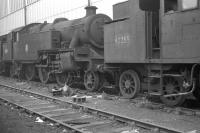 Locomotives awaiting the cutter's torch at Doncaster Works in October 1962 include Fairburn 2-6-4T no 42255 and Stanier 2-6-4T no 42527. The latter is one of the original Tilbury tanks, withdrawn from Shoeburyness shed in June of that year following electrification of the route and cut up here a month after the photograph was taken. <br><br>[K A Gray&nbsp;07/10/1962]