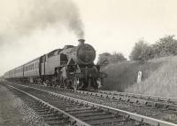 42275 approaching Williamwood from the Muirend direction in June 1955 with a train for Uplawmoor. The embankment on the right carried the line from Muirend to Clarkston East Junction and was used from time to time for the storage of carriages and wagons awaiting repair or scrapping. [See image 9185]