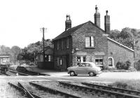 The 1853 station at Sledmere and Fimber in East Yorkshire, thought to have been taken in the mid 1950s. The platform had been shortened to handle surviving goods traffic following closure to passengers in 1950. The line closed completely in 1958 and little now remains here. [Ref query 6931] <br><br>[Peter Todd Collection&nbsp;//]