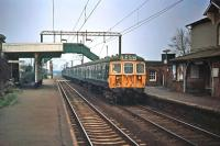 A 12 coach Class 312 Clacton/Walton to Liverpool Street formation passes Alresford (Essex) on 21st November 1976. At the time, these ^outer suburban^ units were fairly new to the line and a reasonable alternative to the well-liked Class 309 units, which were being released from duty for refurbishment.