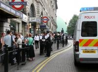 Heavy police presence in and around Baker Street Underground station on Friday 22 July 2005, the day after the failed London bombing attempts. Meanwhile the tall gentleman standing in the background outside number 221b puffs on his pipe and quietly ponders the situation.<br><br>[John Furnevel 22/07/2005]