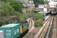 Freightliner 57001 with an eastbound container train approaching Highbury and Islington NLL station in July 2005. Note the mix of overhead and third rail electrification systems in use at this time. <br><br>[John Furnevel&nbsp;22/07/2005]