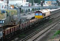 EWS 66250 with an evening PW train passing north through Kensington Olympia on 21 July 2005. Amongst the vehicles is a wagon proclaiming Arsenal FC as <I>Kings of North London</I>. My own slightly mischievous cries of <I>'Come on you Spurrrrs...'</I> went unheeded by the train crew, but did succeed in turning one or two heads on Kensington High Street.<br><br>[John Furnevel&nbsp;21/07/2005]