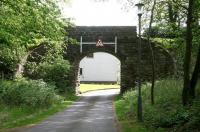 Old preserved overbridge crossing the trackbed of the line heading east out of Peebles towards Galashiels. The route now provides access to 'The Bridges' housing development. For the view from the other side [see image 31892].<br><br>[John Furnevel&nbsp;21/05/2010]
