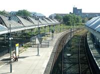 The view south from the footbridge at Tynemouth in the summer of 2004, showing the sad state of the station's former excursion bays and canopies at that time.<br><br>[John Furnevel&nbsp;10/07/2004]