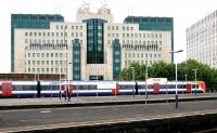 A South West Trains service for Waterloo standing at Vauxhall station in July 2005 in front of a ...well... a certain government building ...errr ...'nuff said...<br><br>[John Furnevel&nbsp;24/07/2005]
