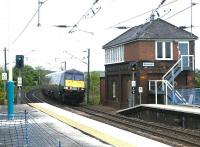 A GNER Edinburgh - Kings Cross train passing Alnmouth signal box in May 2004.<br><br>[John Furnevel&nbsp;28/05/2004]