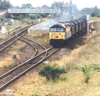 56046 passing Eaglescliffe in August 1997 with a freight off the Northallerton line bound for industrial Teesside. The train has just cleared Eaglescliffe South Junction with the Darlington route diverging west beyond the rear of the train.<br><br>[John Furnevel&nbsp;07/08/1997]