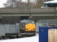 A pair of class 37s with a container train - unloading completed - at WHM Grangemouth in January 2005. DRS 37602 is nearest the camera with 37218 at the head of the train.<br><br>[John Furnevel&nbsp;15/01/2005]