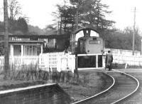 Opening the crossing gates over the A908 at Tillicoultry in October 1971. The train is carrying coal from Dollar mine, destined for Kincardine power station. Part of the platform of Tillicoultry station (closed 1964) is on the left. <br><br>[John Furnevel&nbsp;07/10/1971]