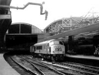 Peak 175 recently arrived at Newcastle Central with a northbound train in September 1969 - receiving strange looks from the water column!<br><br>[John Furnevel&nbsp;30/09/1969]