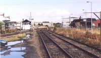 Looking north east towards Keith junction from the Dufftown branch in September 2004. The yard facilitates occasional timber loading and once served the Chivas distillery (on the right). The leftmost building of the Chivas complex incorporates part of the former GNSR locomotive shed (61C). [See image 36513]<br><br>[John Furnevel&nbsp;12/09/2004]