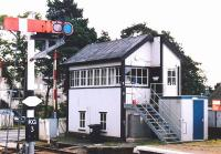 The signal box at Kingussie in 2001, looking east from the down platform with the B970 level crossing beyond.<br><br>[John Furnevel&nbsp;15/09/2001]
