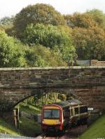 Queen Street bound train about to pass under the Forth and Clyde Canal (rear view).<br><br>[Ewan Crawford&nbsp;28/09/2005]