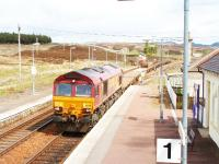 66247 heads south through Dalwhinnie with wagons, some of which contain redundant track, 31/05/05.<br><br>[John Gray&nbsp;//]
