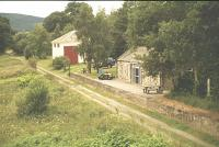 Blacksboat showing the station and goods shed, viewed from road bridge, Summer 1994.<br><br>[John Gray&nbsp;//]