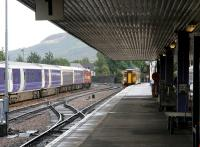 A train for Glasgow Queen Street leaving platform 1 at Fort William on 27 September 2005. The train is passing the stock of the London sleeper stabled in the service siding.<br><br>[John Furnevel&nbsp;27/09/2005]