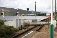 Platform view from Corpach station on 30 September 2005 looking west over the level crossing towards the paper mill.<br><br>[John Furnevel&nbsp;30/09/2005]