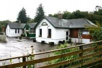 September in the rain at Spean Bridge in 2005, with the station building in use as a restaurant.<br><br>[John Furnevel&nbsp;26/09/2005]