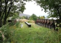 The surviving Lochaber narrow-gauge railway bridge spanning the West Highland Line shortly after it leaves Fort William station. View is towards Loch Linnhe in the autumn of 2005.<br><br>[John Furnevel&nbsp;30/09/2005]