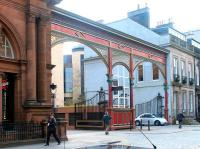 Entrance to the former Princes Street station, Edinburgh, in April 2002. The area immediately beyond the gates is now a car park serving the Caledonian Hotel on the left.<br><br>[John Furnevel&nbsp;28/04/2002]
