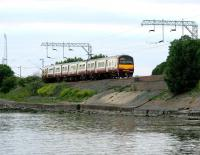 A Helensburgh bound train skirts the north shore of the River Clyde near Cardross in July 2005.<br><br>[John Furnevel&nbsp;27/07/2005]