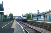 A GNER Edinburgh - London train speeds south through Acklington station, Northumberland, in May 2004.<br><br>[John Furnevel&nbsp;24/05/2004]