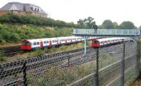Eastbound Piccadilly line tube trains from Heathrow (left) and Rayners Lane meet just west of Acton Town station on 21 July 2005.<br><br>[John Furnevel&nbsp;21/07/2005]