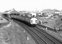 A Glasgow Central - Ayr train passing Ayr MPD and about to run through Hawkhill Junction in April 1975. Note the unidentified EE Type 4 on the right waiting with a train on the spur between Blackhouse and Hawkhill Junctions.<br><br>[John Furnevel&nbsp;04/04/1975]