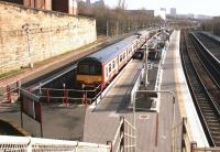 Looking south from the station footbridge at Springburn on 14 February 2005 with a train for Dalmuir awaiting its departure time in platform 3.<br><br>[John Furnevel&nbsp;14/02/2005]
